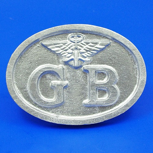 cast GB plate with Austin wings